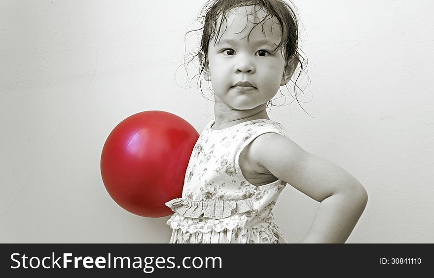 Little girl with red ball
