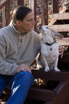 Free Man Kissing Dog Stock Photo - 30877750
