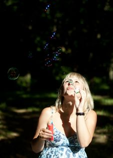Free Young Pregnant Woman Blowing Soap Bubbles Royalty Free Stock Photos - 30886298