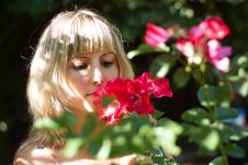 Free Young Woman With Red Flowers On A Walk Stock Photo - 30886300