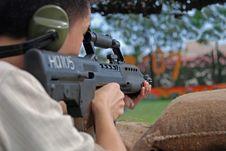 People Firing Machine Gun Stock Photo