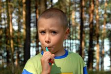 Young Boy Is Brushing His Teet Royalty Free Stock Photos