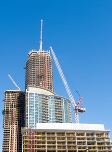 Free Crane On Top Of New Condo Tower Royalty Free Stock Photo - 30914855