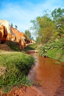Landscape With Red River Between Rocks And Jungle. Vietnam Royalty Free Stock Photo