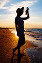Free Silhouette Of Sexy Girl In Hat Holding Grapes Royalty Free Stock Photo - 30935205