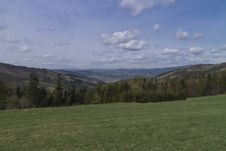 Free Mountain Meadow And Cloudy Sky Royalty Free Stock Image - 30933536
