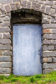 Free Stone Wall With Arch And Metal Door Stock Images - 30935014