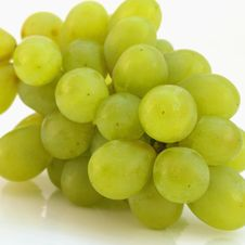 Bunch Of Grapes On A Light Background Royalty Free Stock Photos