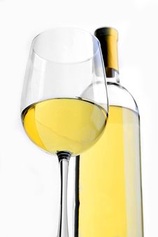 A Glass Of White Wine With A Wine Bottle Royalty Free Stock Images