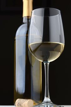 A Glass Of White Wine And Wine Bottle Royalty Free Stock Photos