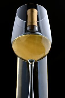 Free A Glass Of White Wine And Wine Bottle Stock Photos - 30946123