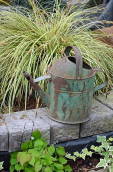 Free Old Rusty Watering Can Royalty Free Stock Photography - 30946947