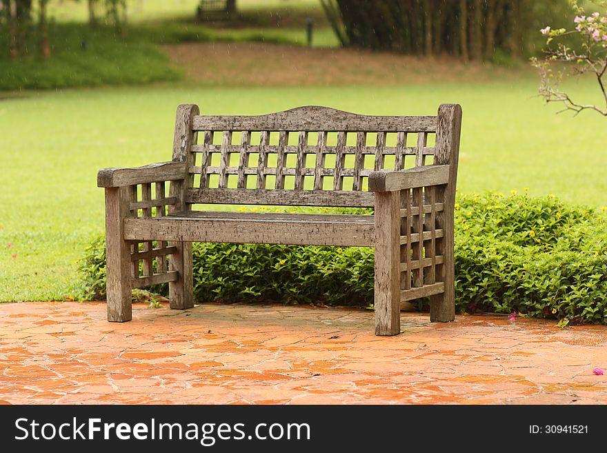 A chair in rain at botanic garden