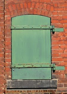 Free Green Metal Door In A Brick Wall. Royalty Free Stock Photos - 30962448
