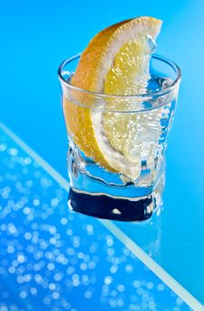 Free Gin With Lemon On A Glass Table Stock Image - 30963761