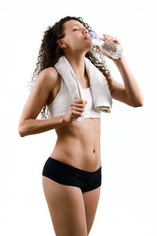 Free Young Woman Wearing Sport Clothes And Drinking Water On White Ba Royalty Free Stock Photo - 30968895