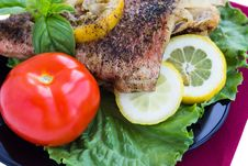 Free Baked Grouper Served With Lemon And Basil On Black Plate Stock Image - 30979141