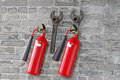 Free Fire Extinguishers And Spanners Hanged On Brick Wall Stock Photography - 30989782