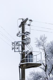 Free Old Concrete Power-line With Transformer And Winter-tree Royalty Free Stock Image - 30982686