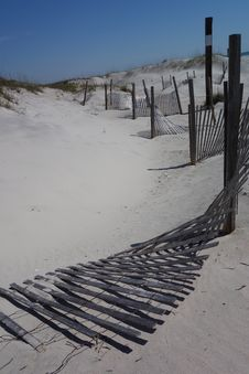 Fences On White Sandy Beach Stock Image