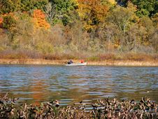 Free Boaters On Autumn Lake Stock Photography - 311162