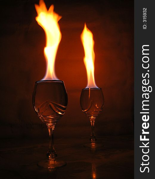 Flame above glasses.