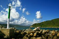 Free Lighthouse And Stones Stock Image - 3101451
