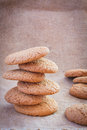 Free Stacked Brown Cookies On Rustic Background Royalty Free Stock Photo - 31009175