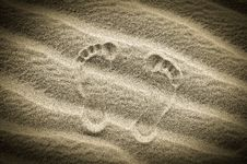 Free Two Footprints In Sand On The Desert Beach Stock Photos - 31026133