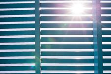 Blue Wooden Lath With Lens Flare Royalty Free Stock Image