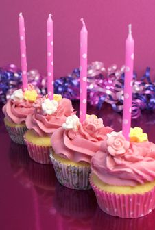 Pink Brithday Cupcakes With Polka Dot Candles - Vertical. Royalty Free Stock Photo