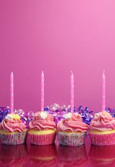 Pink Birthday Cupcakes With Polka Dot Candles - Vertical With Copy Space. Stock Image