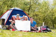 Free Youth On A Camping With An Empty Sign Board Royalty Free Stock Photos - 31058288