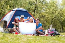 Free Teenagers On A Camping With An Empty Sign Board Stock Images - 31058294