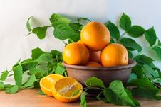 Free Still Life Of Oranges In A Clay Bowl Royalty Free Stock Photo - 31069385