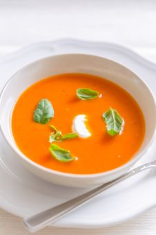 Free Fresh Tomato Cream Soup Garnished With Basil Stock Photography - 31070482