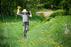 Girl With Dandelions Up Air Stock Photo