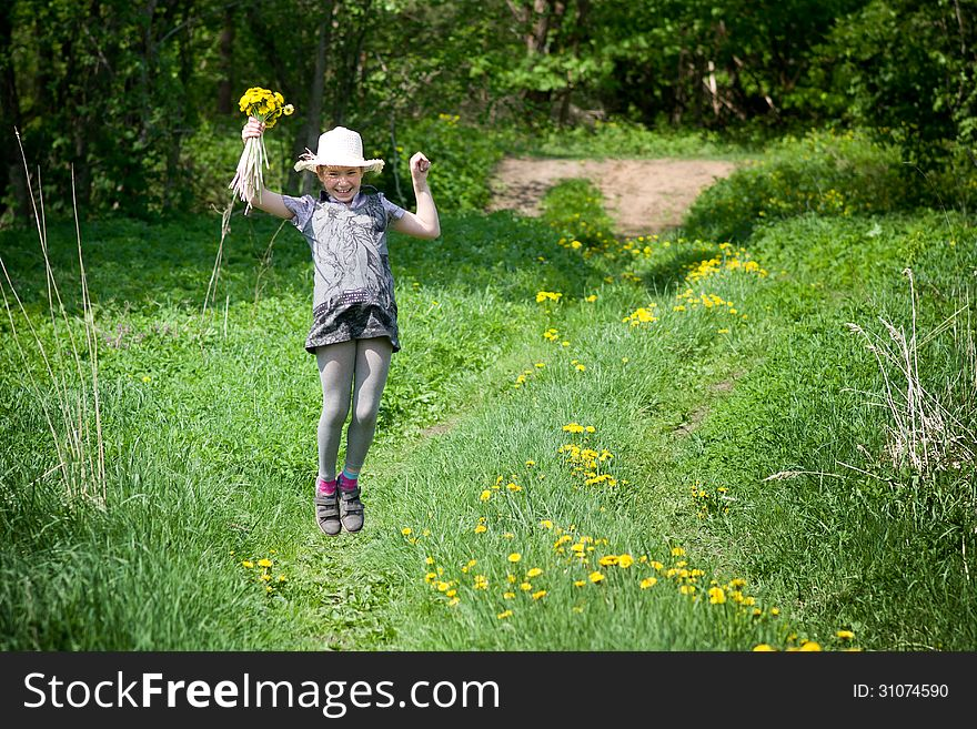 Girl with dandelions up air