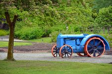 Blue And Orange Tractor Royalty Free Stock Photos
