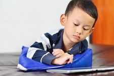 A Boy Playing A Game On Computer Tablet Royalty Free Stock Photos