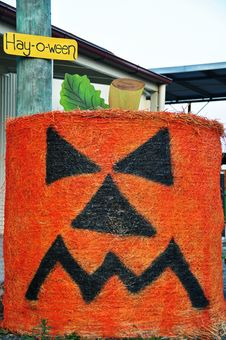 Grumpy Pumpkin Face Halloween Round Hay Bale Stock Photos