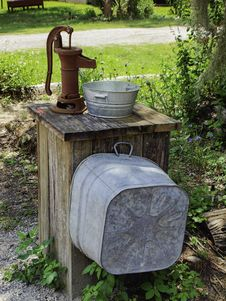 Old Pump And Buckets Stock Images