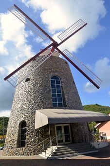 Free Old Sugar Mill Replica Powered By Wind Mill Stock Image - 31125521