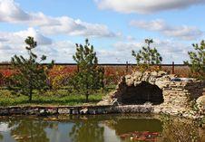 Garden With A Pond And A Grotto Stock Photos