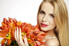 Beautiful Blonde Girl With The Bouquet Of Tulips Isolated On A W