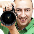 Free Portrait Of The Smiling Photographer. Royalty Free Stock Image - 31171366
