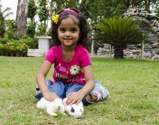 Free Girl Playing With Rabbits. Royalty Free Stock Image - 31173086