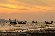 Free Fishing Boats Floating In Sunset Royalty Free Stock Image - 31178106
