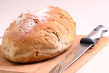 Free Loaf Of Bread And Knife On A Cutting Board Stock Images - 31186234