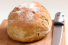 Free Loaf Of Bread And Knife On A Cutting Board Royalty Free Stock Images - 31186249